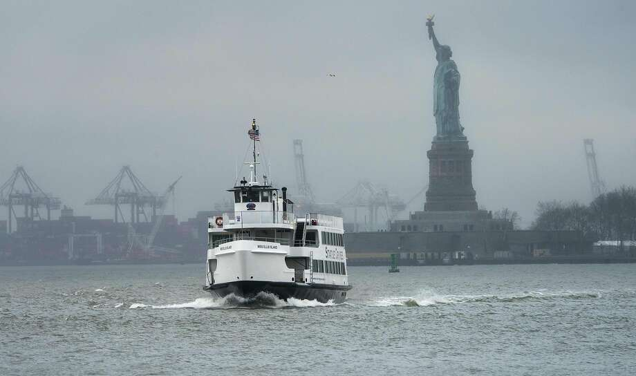 The Ellis Island ferry transports passengers with the Statue of Liberty as a backdrop in New York City. State funds are being used to keep the attractions open during the federal shutdown. Photo: Don Emmert / AFP / Getty Images