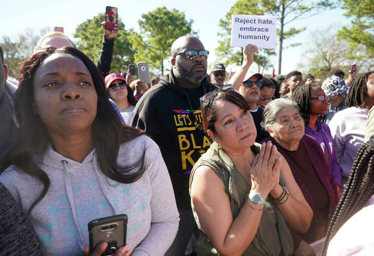 People attend a community rally outside Walmart, 5655 East Sam Houston Pkwy N, for seven-year-old Jazmine Barnes, who was shot and killed nearby Sunday.