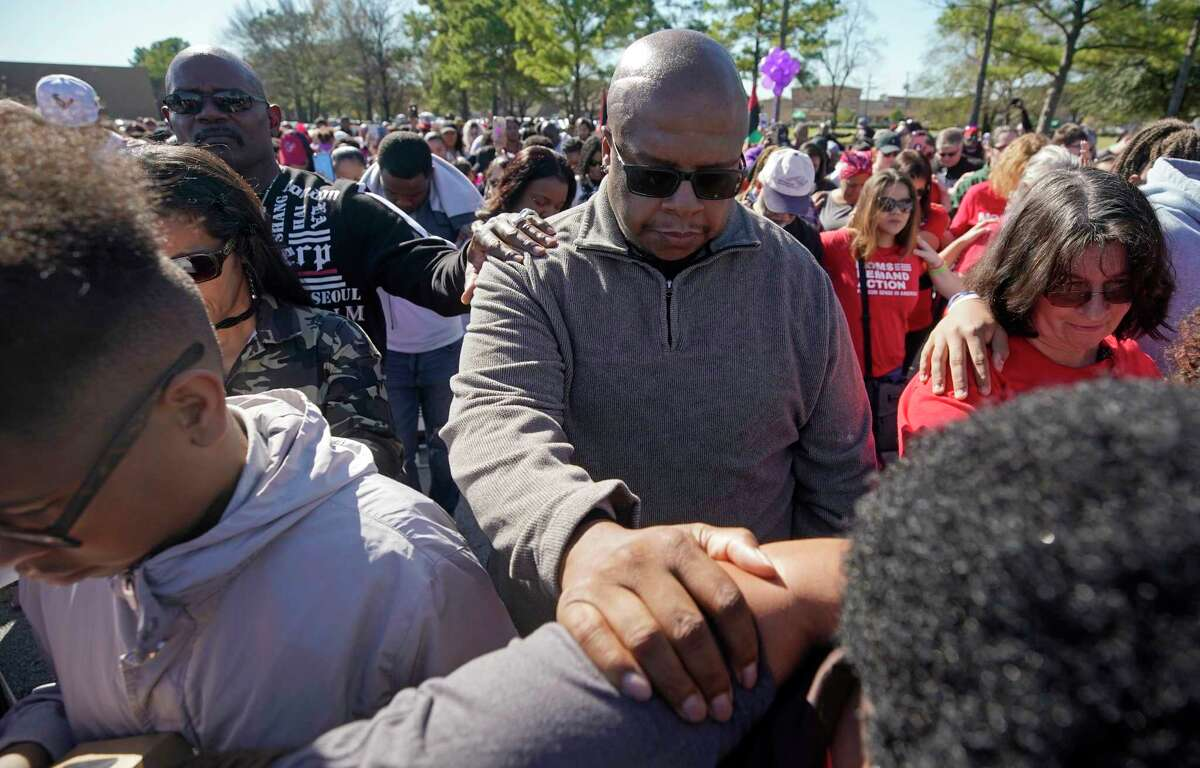 People pray during a community rally outside Walmart, 5655 East Sam Houston Pkwy N, Saturday, Jan. 5, 2019, in Houston for seven-year-old Jazmine Barnes, who was killed on Sunday. Jazmine was shot to death nearby while riding in a car with her mother and three sisters.