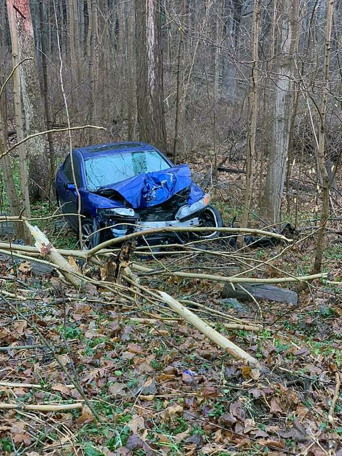 On Saturday, Jan. 5, 2019, Ansonia, Conn., first responders found a heavily damaged car of the roadway. Photo: Contributed Photo / Ansonia Rescue And Medical Services / Contributed Photo / Connecticut Post Contributed