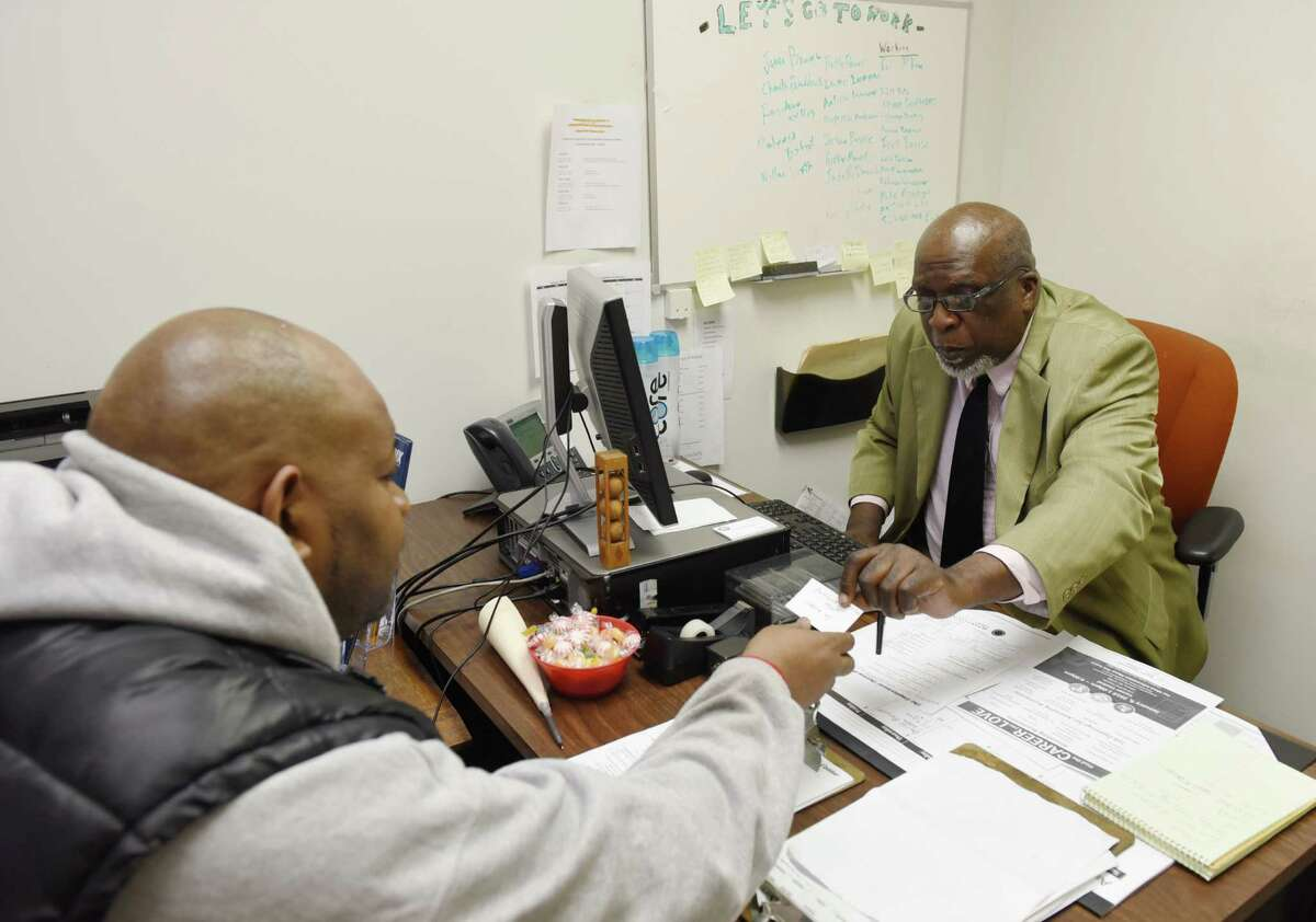 Assistant Community Program Educator Maurice Rucker works with a client on a job search consultation Thursday, Jan. 3, 2019 at the Albany County Probation Department in Albany, N.Y. (Phoebe Sheehan/Times Union)