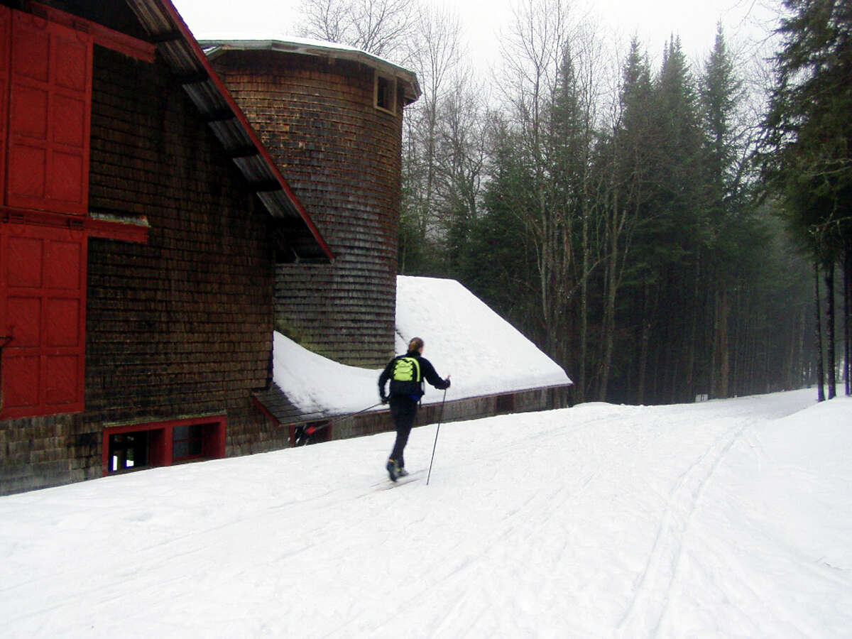 ** FOR IMMEDIATE RELEASE **Liza Goodwin, 13, of Keene, N.Y., skis past the barn at the Farm Complex on the the road to the Santanoni camp on Newcomb Lake in Newcomb, N.Y., Jan. 3, 2004. Santanoni is a popular destination with backcountry skiers. (AP Photo/Tony Goodwin)