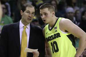 Baylor head coach Scott Drew, left, speaks with Makai Mason during a recent game.