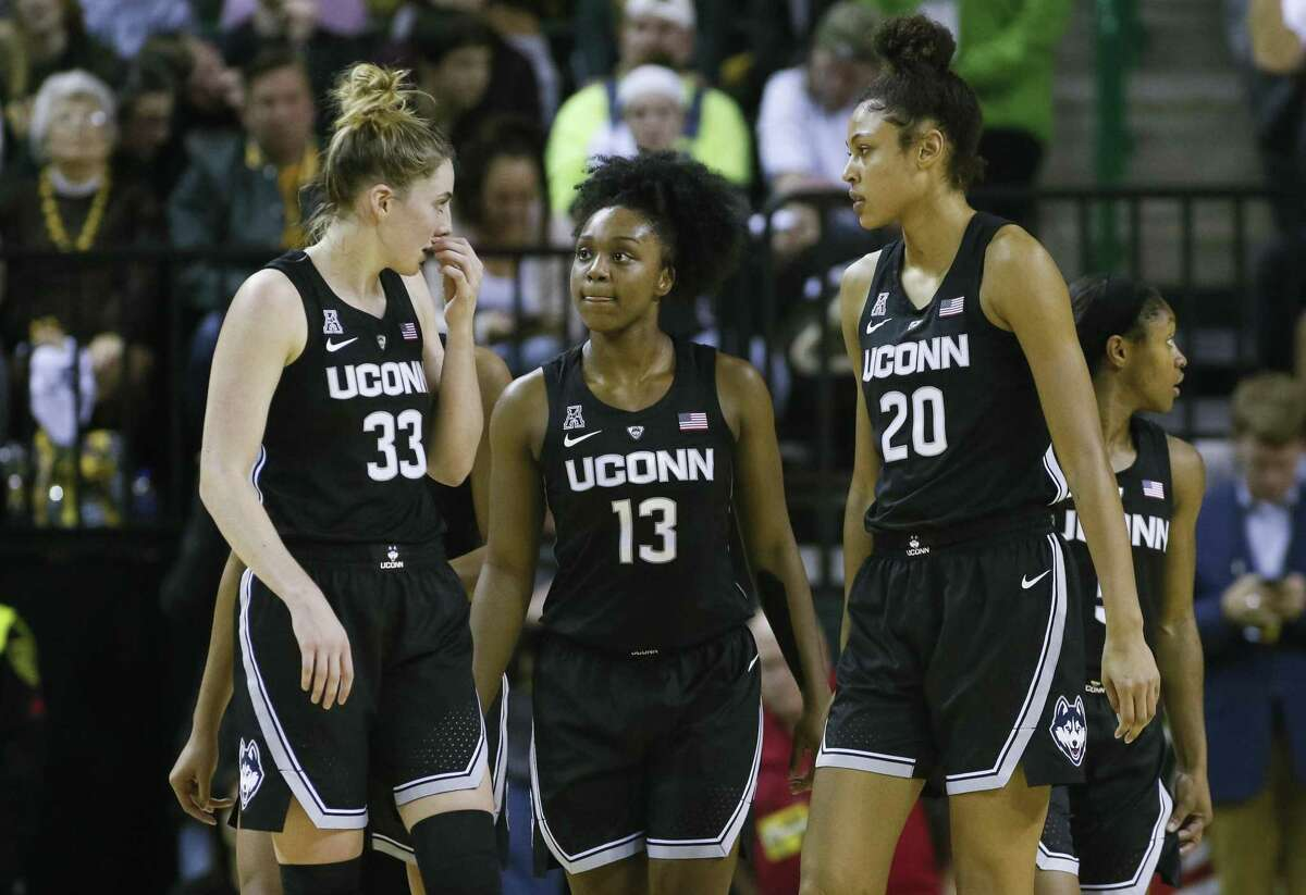 UConn guard/forward Katie Lou Samuelson (33), guard Christyn Williams (13) and forward Olivia Nelson-Ododa (20) talk after a timeout against Baylor on Thursday.