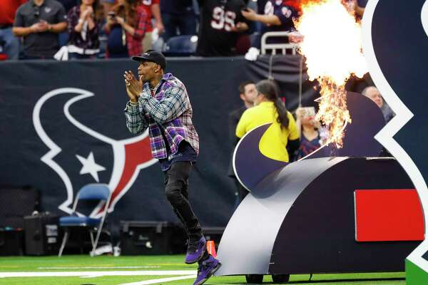 67872a9e1c49 Travis Scott on the field for Texans-Colts playoff game ...