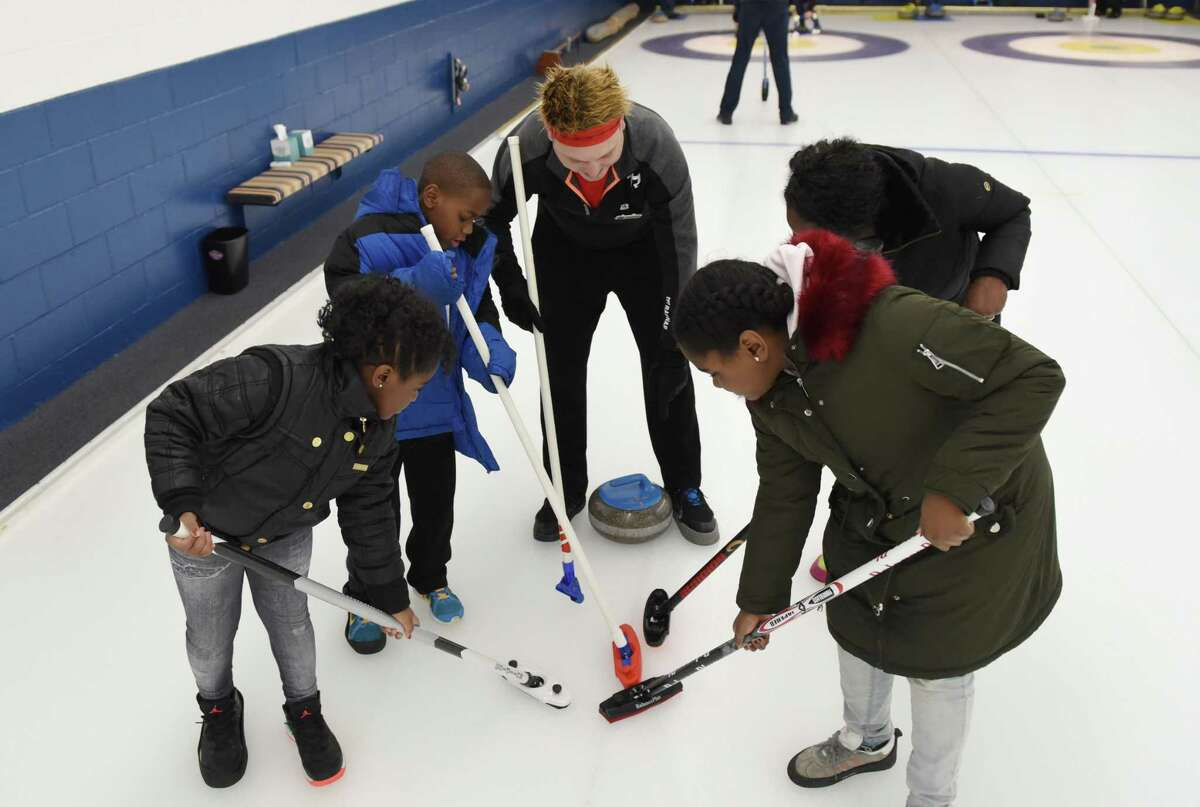 Solon Boomer-Jenks teaches how to sweep in curling during the Albany Curling Club open house Saturday, Jan. 5, 2019 at the Albany Curling Club in Albany, N.Y. (Phoebe Sheehan/Times Union)