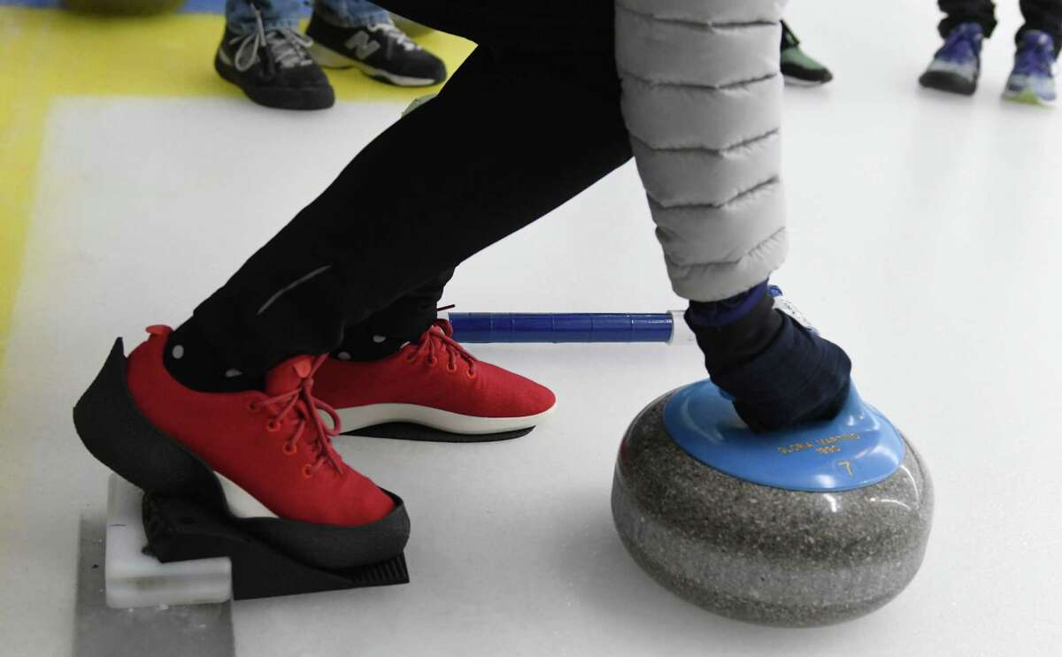 Penny Ruhm gets in position to deliver the stone during the Albany Curling Club open house Saturday, Jan. 5, 2019 at the Albany Curling Club in Albany, N.Y. (Phoebe Sheehan/Times Union)