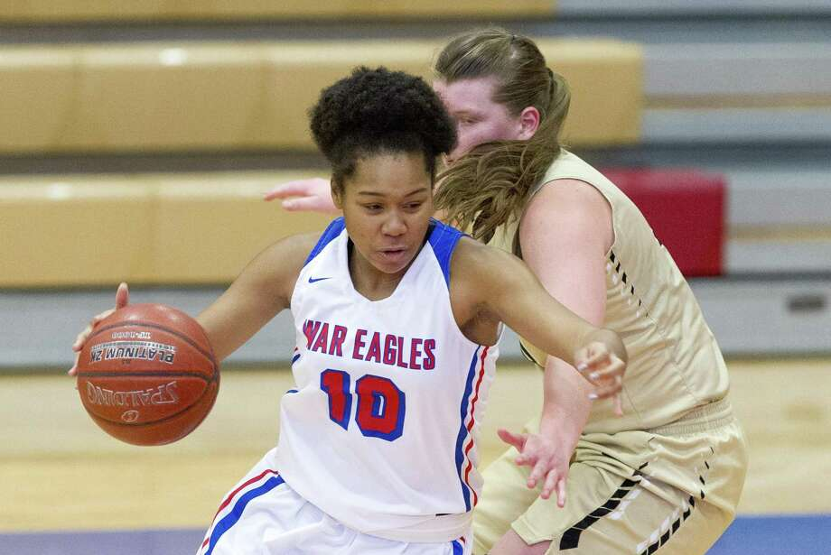 Oak Ridge forward Janiya Maxie (10) gets past Conroe center Lilly Rodel (34) during the third quarter of a District 15-6A high school basketball game at Oak Ridge High School, Saturday, Jan. 5, 2019, in Oak Ridge. Photo: Jason Fochtman, Houston Chronicle / Staff Photographer / © 2018 Houston Chronicle
