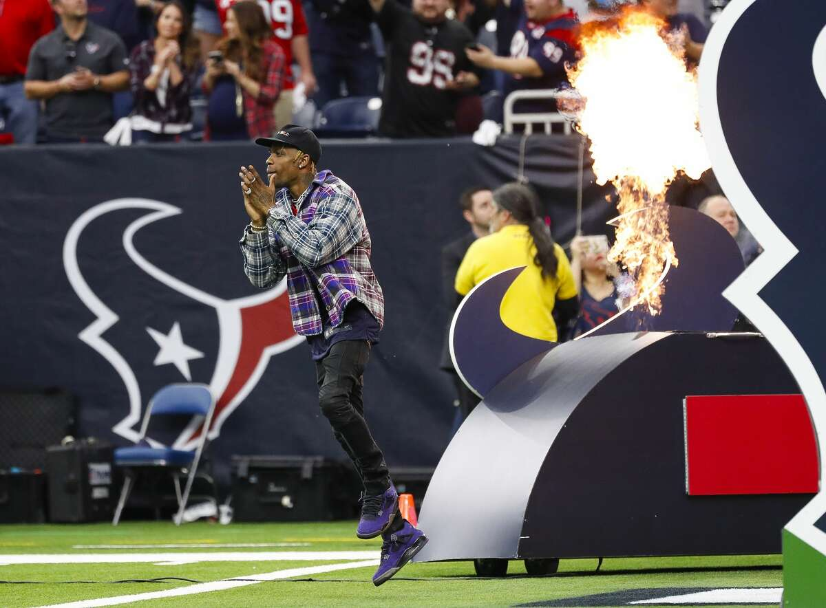 Houston hip hop artist Travis Scott is welcomed to the field before the AFC Wild Card playoff game between the Texans and the Indianapolis Colts on Jan. 5, 2019.