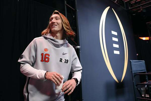 0540f9c54 1of3Clemson Tigers quarterback Trevor Lawrence walks on the stage for  interviews at the College Football Playoff National Championship media day  at the SAP ...