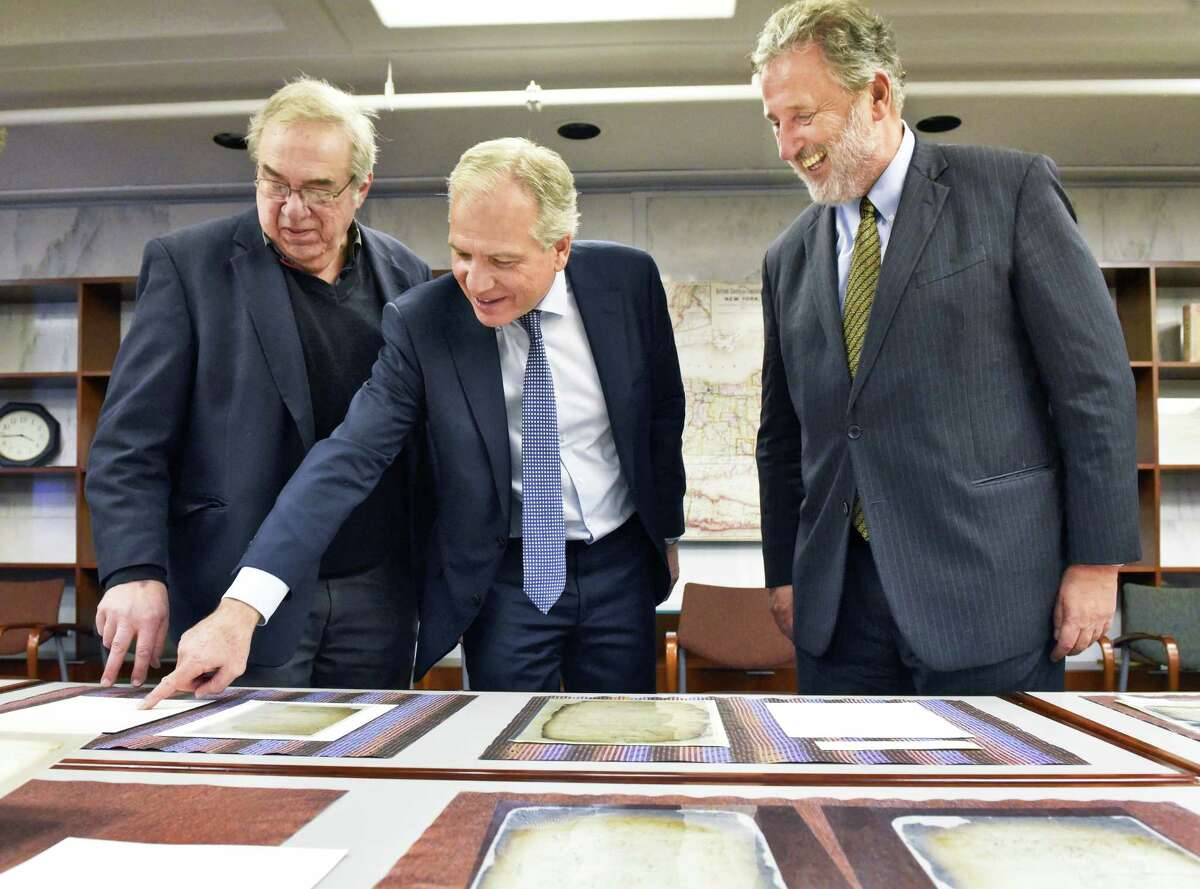 Director of the New Netherland Project Charles Gehring, left, Consul General of the Netherlands Dolph Hogewoning and Ambassador of the Netherlands Henne Schuwer, right, look over 17C Dutch papers from Van Rensselaer Manor during a tour the New York State Museum Tuesday Dec. 13, 2016 in Albany, NY. (John Carl D'Annibale / Times Union)