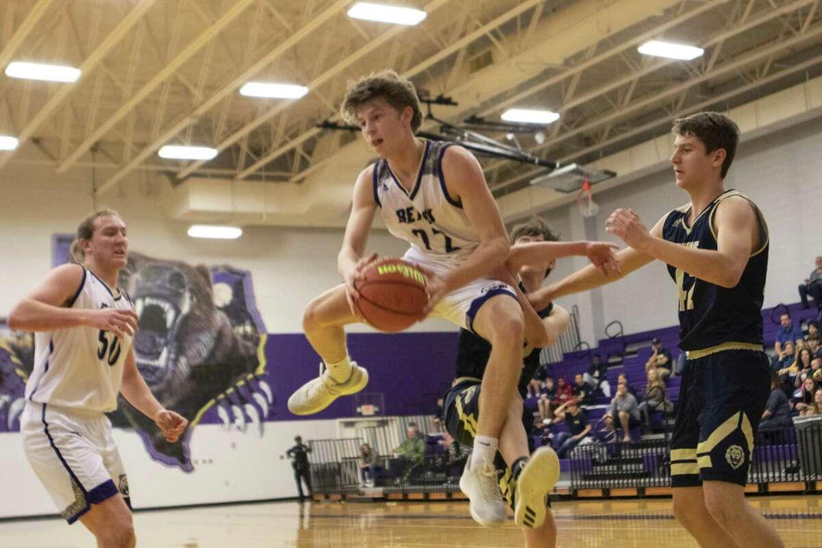 Montgomery junior Tyler Elliott recovers a rebound during a District 20-5A high school basketball game Saturday, Jan. 5, 2019 at Montgomery High School in Montgomery.