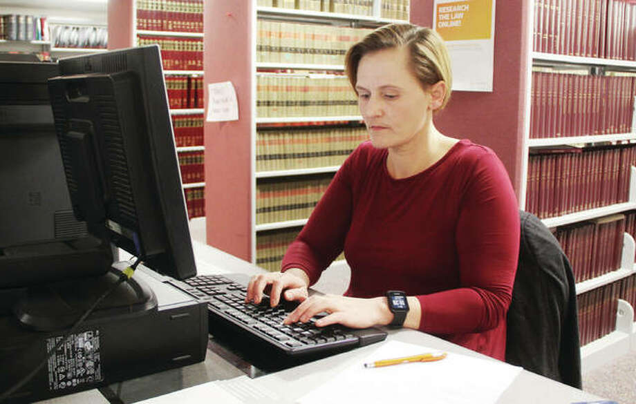 Edwardsville-based attorney Janel Freeman uses one of the computers in the Madison County Law Library earlier this year to research court cases for an appeal. The library, which also serves as a self-help center for people representing themselves in the court system, offers both bound volumes and online records. Use increased dramatically in 2018, jumping to more than 12,000 from about 8,000 in 2017. Photo: Scott Cousins | The Telegraph
