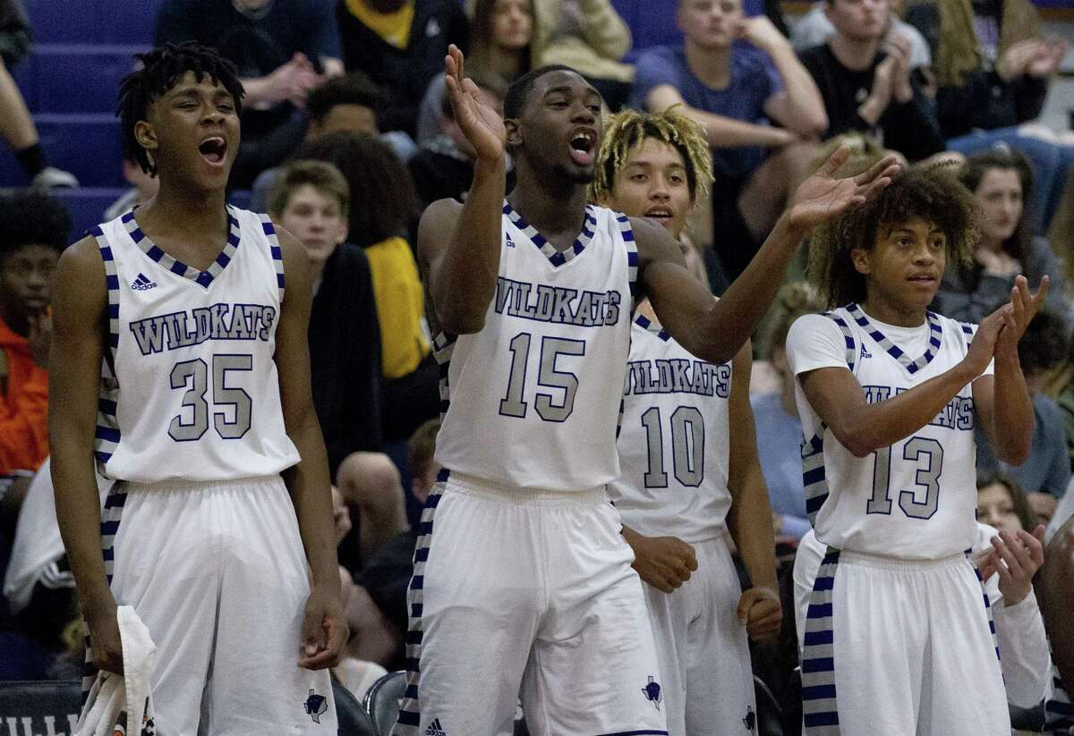 In this file photo, Willis forward Ja'len Moore (35), center Ja'Kobe Caldwell (15) and point guard D'Shawn Woods (13) cheer during the third quarter of a District 20-5A high school basketball game at Willis High School, Tuesday, Dec. 18, 2018, in Willis.