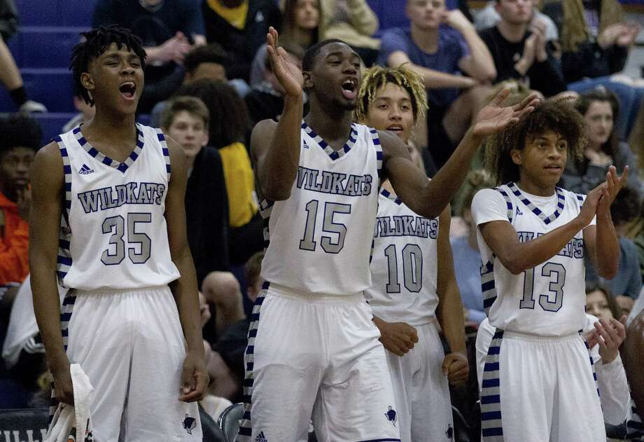 In this file photo, Willis forward Ja'len Moore (35), center Ja'Kobe Caldwell (15) and point guard D'Shawn Woods (13) cheer during the third quarter of a District 20-5A high school basketball game at Willis High School, Tuesday, Dec. 18, 2018, in Willis. Photo: Jason Fochtman, Houston Chronicle / Staff Photographer / © 2018 Houston Chronicle