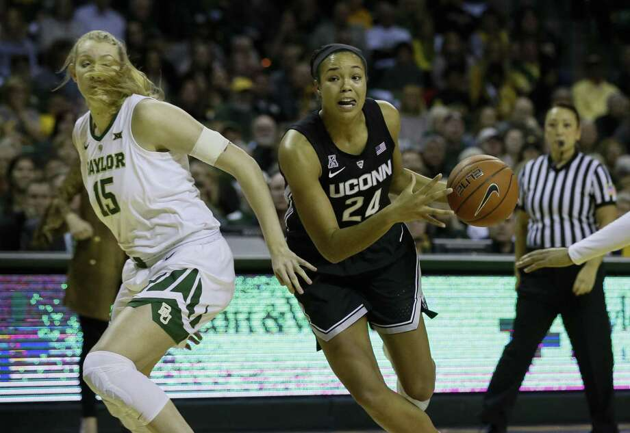 UConn forward Napheesa Collier (24) works her way past Baylor forward Lauren Cox on Thursday. Photo: Ray Carlin / Associated Press / Copyright 2019 The Associated Press. All rights reserved.