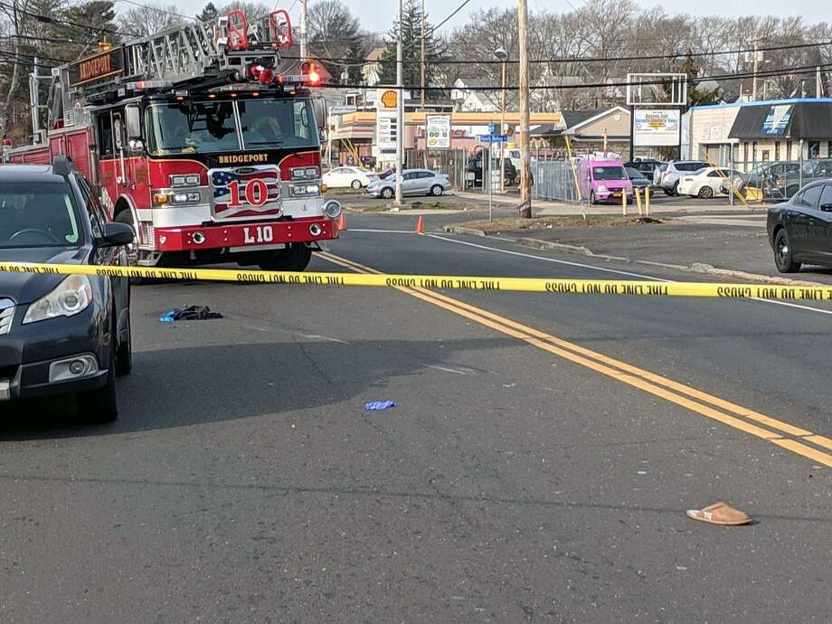 A fire department crew at the scene of a hit-and-run accident  in Bridgeport on Friday. Photo: Contributed Photo / Contributed Photo / Connecticut Post Contributed