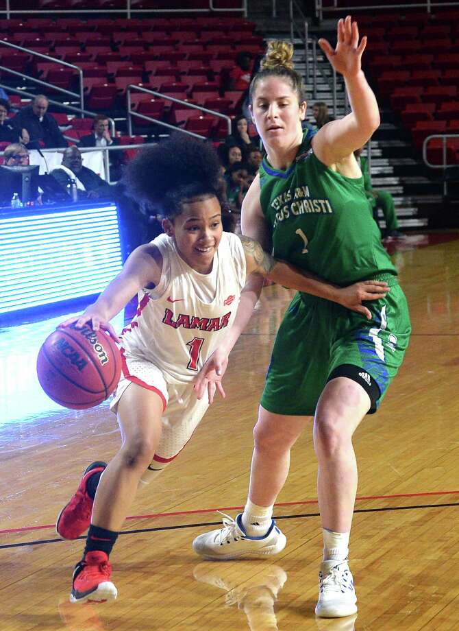 Lamar's Jadyn Pimentel drives past Texas A&M - Corpus Christi's Giana Wright during their match-up Sarurday at the Montagne Center.  Photo taken Saturday, January 5, 2019  Photo by Kim Brent/The Enterprise Photo: Kim Brent, The Enterprise / BEN