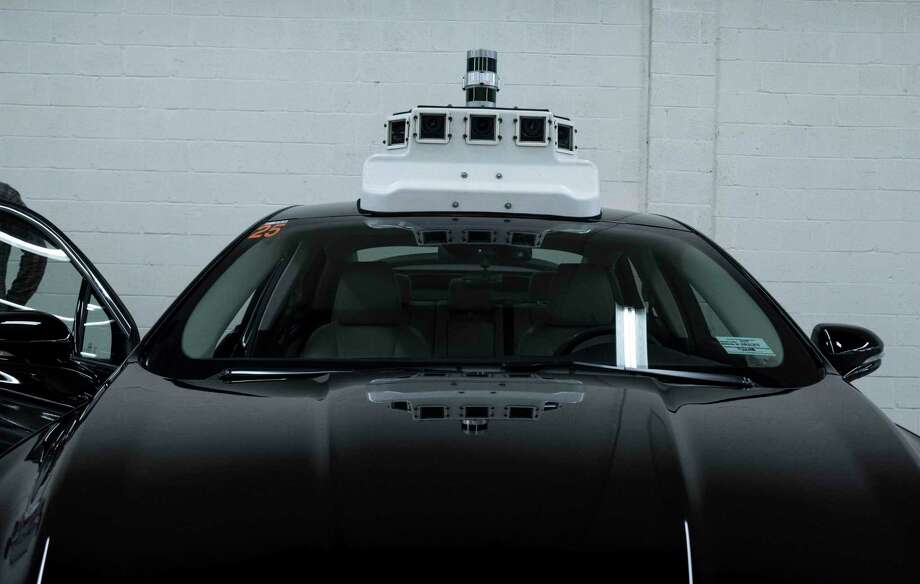 A Ford vehicle that will eventually be made into a self-driving car is outfitted with cameras at the Ford terminal in Washington, D.C. Photo: Washington Post Photo By Calla Kessler / The Washington Post
