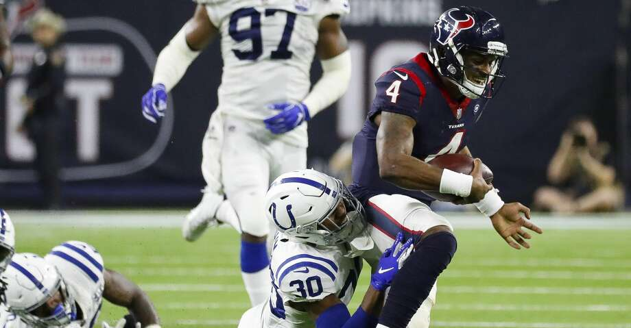 PHOTOS: Texans vs. Colts Houston Texans quarterback Deshaun Watson (4) runs during the fourth quarter of an NFL first round playoff game at NRG Stadium, Saturday, Jan. 5, 2019, in Houston. Browse through the photos to see action from the Texans' playoff loss to the Colts on Saturday. Photo: Karen Warren/Staff Photographer