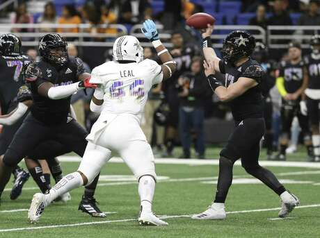 West Team's DeMarvin Leal of Judson High School (44) rushes East Team quarterback Sam Howell (17) in the 2019 All-American Bowl at the Alamodome on Saturday, Jan. 5, 2019. The sporting event featured 100 of the top senior football players from across the country. East defeated the West, 48-14. (Kin Man Hui/San Antonio Express-News)