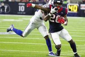 Houston Texans running back Lamar Miller (26) is knocked out of bounds before the endzone during the fourth quarter of an NFL first round playoff game at NRG Stadium, Saturday, Jan. 5, 2019, in Houston.