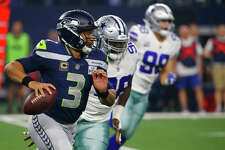 Seattle Seahawks quarterback Russell Wilson (3) runs out of the pocket against the Dallas Cowboys during the first half of the NFC wild-card NFL football game in Arlington, Texas, Saturday, Jan. 5, 2019. (AP Photo/Ron Jenkins)
