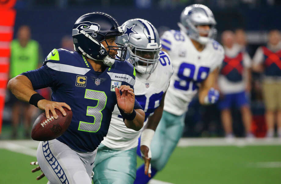 Seattle Seahawks quarterback Russell Wilson (3) runs out of the pocket against the Dallas Cowboys during the first half of the NFC wild-card NFL football game in Arlington, Texas, Saturday, Jan. 5, 2019. (AP Photo/Ron Jenkins) Photo: AP Photo / Copyright 2019 The Associated Press. All rights reserved.