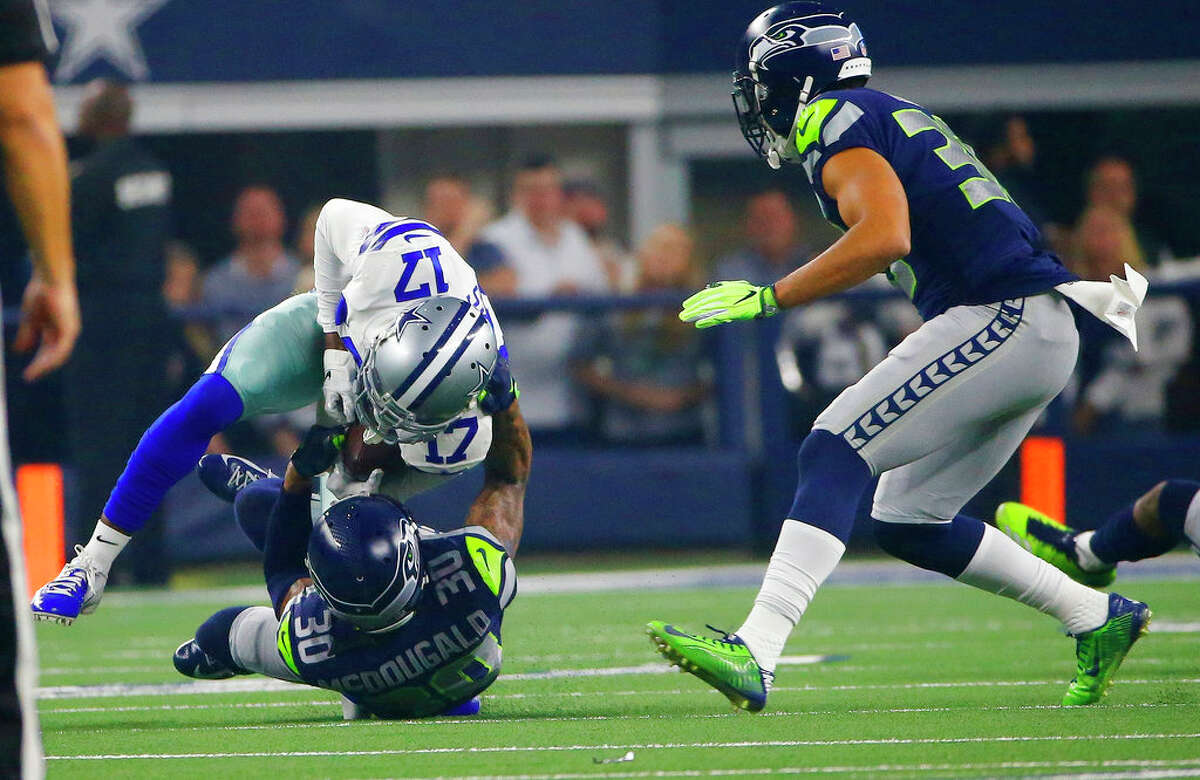 Dallas Cowboys wide receiver Allen Hurns (17) is hit by Seattle Seahawks strong safety Bradley McDougald (30) during the first half of the NFC wild-card NFL football game in Arlington, Texas, Saturday, Jan. 5, 2019. (AP Photo/Ron Jenkins)