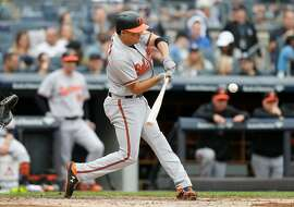 EW YORK, NY - SEPTEMBER 23: Breyvic Valera #28 of the Baltimore Orioles in action against the New York Yankees at Yankee Stadium on September 23, 2018 in the Bronx borough of New York City. The Orioles defeated the Yankees 6-3. (
