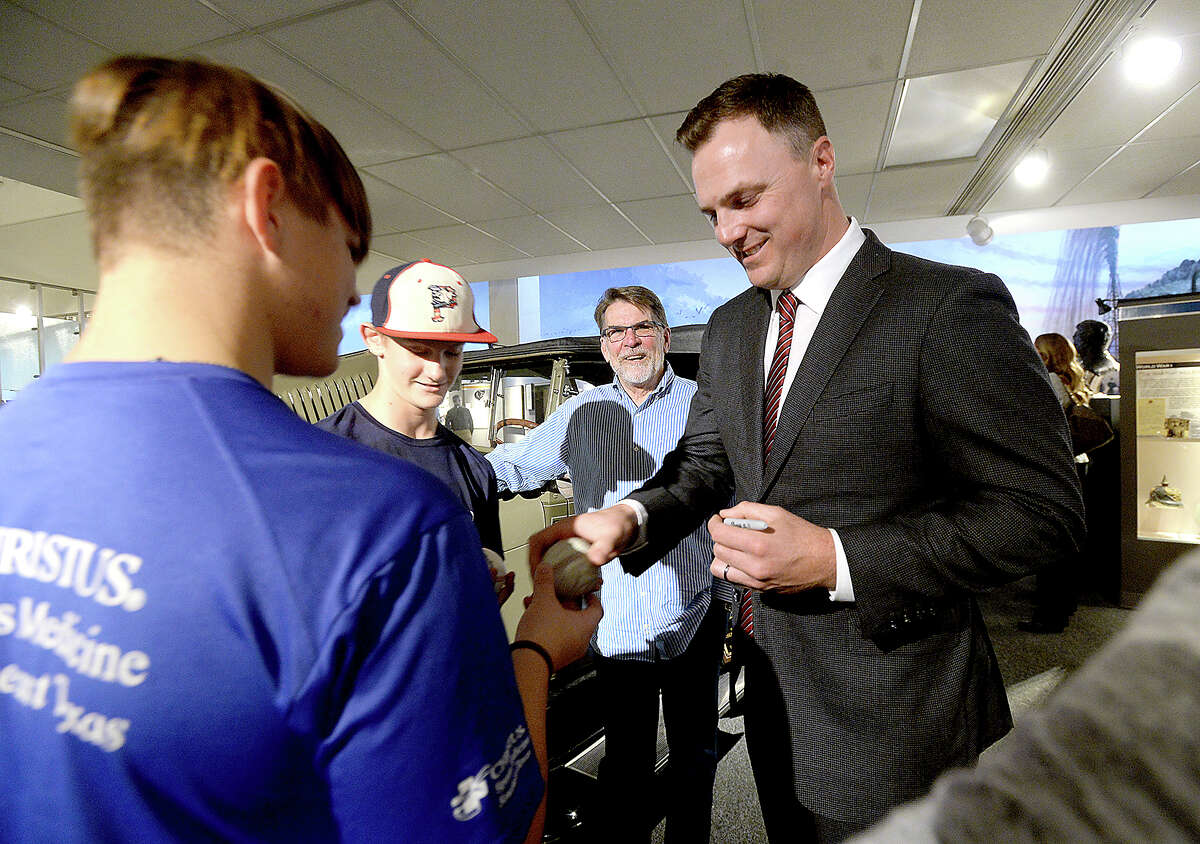 West Brook graduate and major league baseball player Jay Bruce autographs baseballs for fans and catches up with old friends before his induction in to the Sports Hall of Fame at the Museum of the Gulf Coast Saturday. Bruce, a right-fielder, now plays for the Seattle Mariners. He was a first round draft straight out of high school for the Cincinnati Reds' amateur and minor league clubs in 2005, where he worked his way up to the majors with the Reds n 2008. Bruce also played for the New York Mets and Cleveland Indians. Photo taken Saturday, January 5, 2019 Photo by Kim Brent/The Enterprise