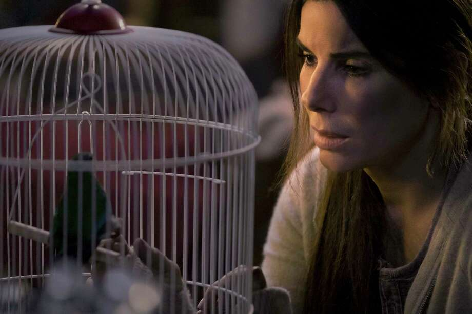 """This image released by Netflix shows Sandra Bullock in a scene from the film, """"Bird Box."""" Netflix said Wednesday, Jan. 2, 2019, that 45 million subscriber accounts worldwide watched the Bullock thriller """"Bird Box"""" during its first seven days on the service, the biggest first-week success of any movie made for the company's nearly 12-year-old streaming service. (Merrick Morton/Netflix via AP) Photo: Merrick Morton / Netflix"""