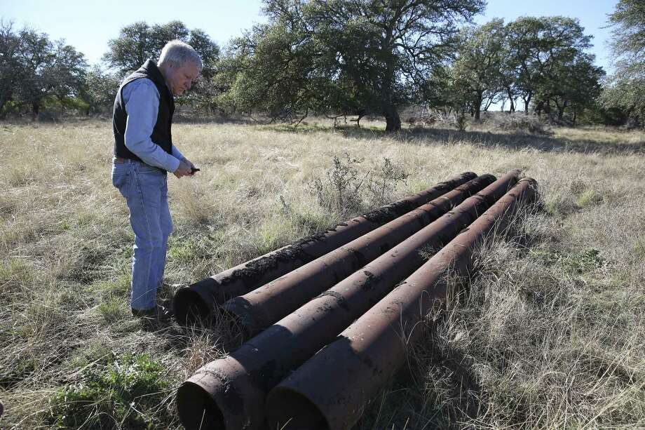 Andy Sansom, manager of the historic Hershey Ranch in Stonewall, stands near a series of old pipeline left on the property on Thursday, Dec. 27, 2018. Sansom is concerned about the environmental impact of new pipeline which will carry natural gas and that will run through the property. Kinder Morgan wants to build a 42-inch natural gas pipeline south of Fredericksburg, Texas and that has alarmed land owners, small and large, that a large, 42-inch diameter natural gas pipeline will intrude onto their properties. The impending construction and potential dangers of having such a pipeline on their land have some concerned about the environmental impact such a pipeline will have in the surrounding area. (Kin Man Hui/San Antonio Express-News) Photo: Kin Man Hui, Staff Photographer / San Antonio Express-News / ©2018 San Antonio Express-News
