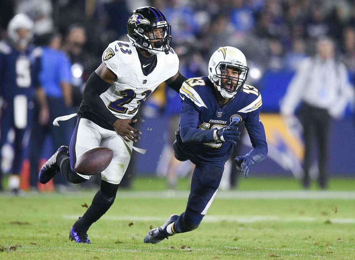 Baltimore Ravens safety Tony Jefferson, left, holds onto Los Angeles Chargers wide receiver Keenan Allen as Allen attempts a catch resulting in a pass interference during the first half of an NFL football game in Carson, Calif., Sunday, Dec. 23, 2018. (AP Photo/Kelvin Kuo)