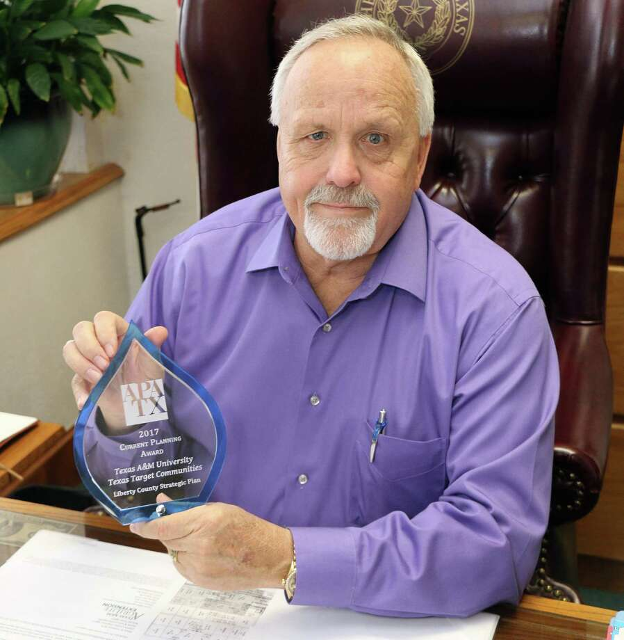 Liberty County Judge Jay Knight holds the state-wide award presented to the county and Texas A& students for the Liberty County Economic Development Strategic Plan. Residents can find the plan on the county's website. Photo: David Taylor / HCN