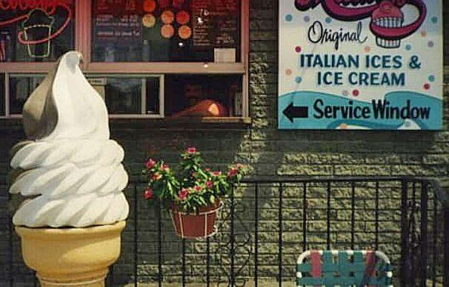 Jay Piccirillo, the owner of Micalizzi's Italian Ice at 712 Madison Ave., said in a Facebook post on Friday that someone stole the ice cream cone prop from the store, seen in this photo on the left. Photo: Contributed Photo / Jay Piccirillo / Contributed Photo / Connecticut Post Contributed