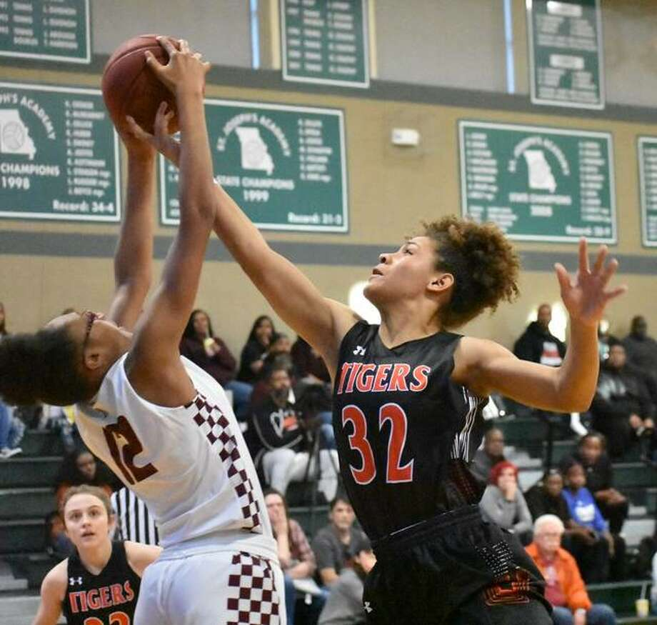 Edwardsville forward Maria Smith goes up for a rebound against Cardinal Ritter in the first quarter at the St. Joseph's Shootout on Saturday. Photo: Matt Kamp/Intelligencer