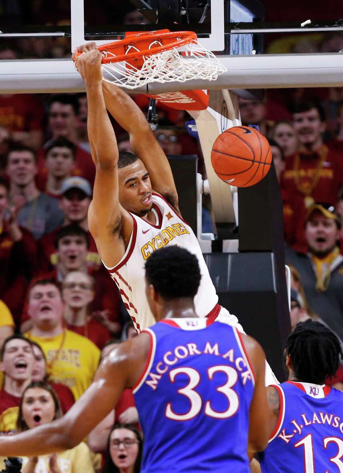 AMES, IA - JANUARY 5: Talen Horton-Tucker #11 of the Iowa State Cyclones dunks the ball as David McCormack #33 of the Kansas Jayhawks, and K.J. Lawson #13 of the Kansas Jayhawks defend in the second half of play at Hilton Coliseum on January 5, 2019 in Ames, Iowa. The Iowa State Cyclones won 77-60 over the Kansas Jayhawks. (Photo by David Purdy/Getty Images)