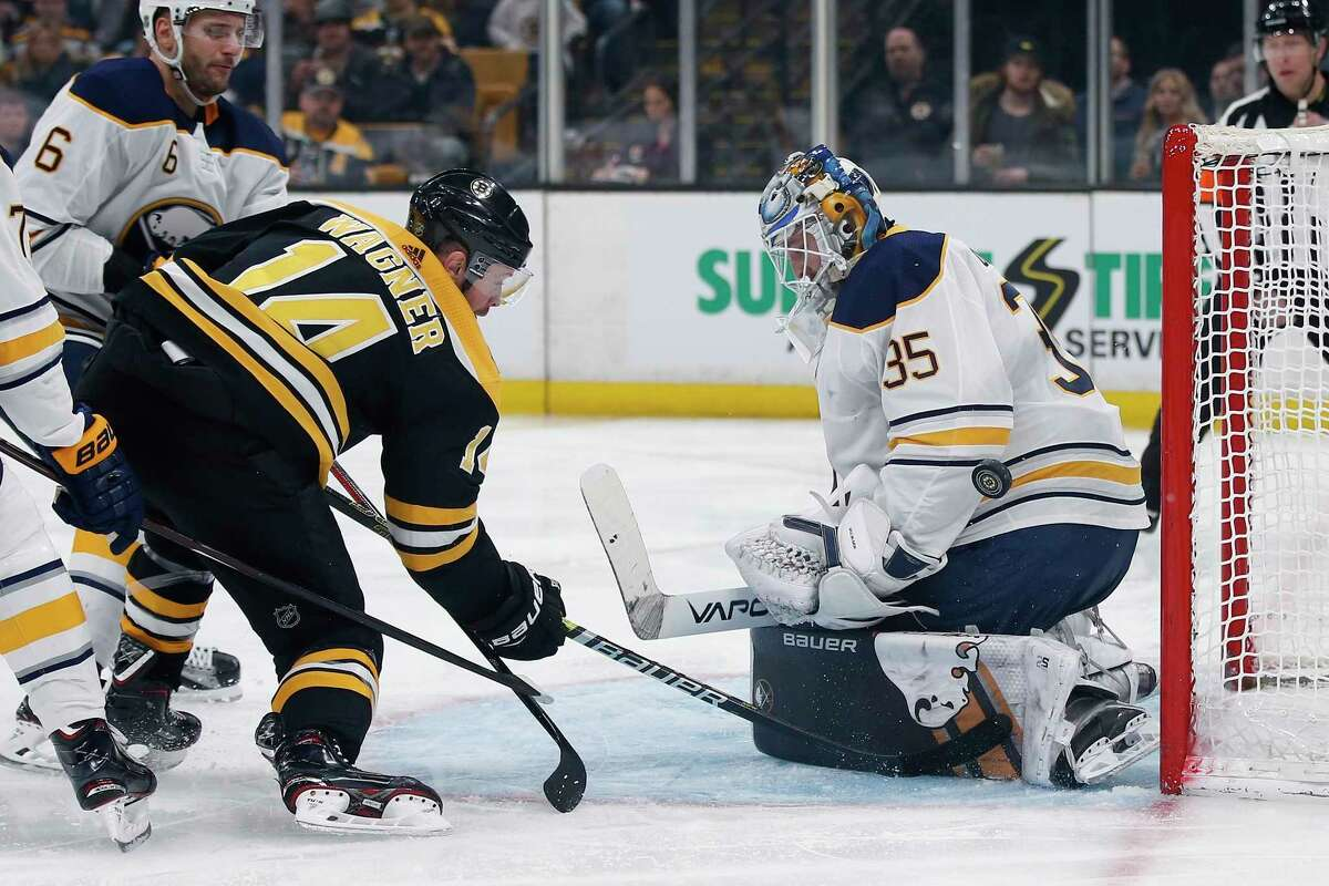Buffalo Sabres' Linus Ullmark (35) blocks a shot by Boston Bruins' Chris Wagner (14) during the second period of an NHL hockey game in Boston, Saturday, Jan. 5, 2019. (AP Photo/Michael Dwyer)