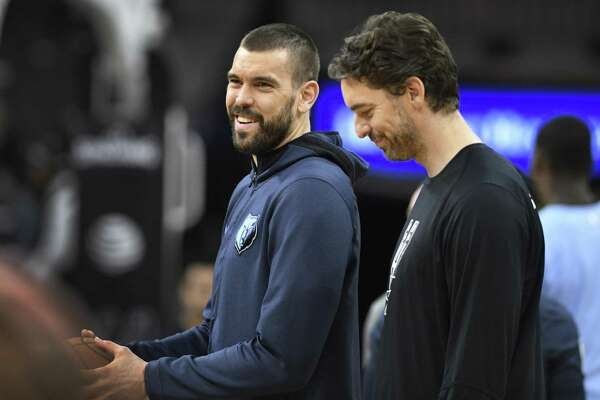 Brothers Marc Gasol, left, of the Memphis Grizzlies and Pau Gasol of the San Antonio Spurs converse before NBA action in the AT&T Center on Saturday, Jan. 5, 2019.