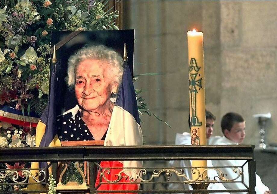 (FILES) In this file photo taken on August 7, 1997 shows a picture of late Jeanne Calment during a memorial mass at the Primatiale Sainte-Trophime church. - What if Jeanne Calment's longevity record was a fraud? Russian researchers have concluded an incredible sleight of hand between the French woman and her daughter, provoking interest and controversy in the scientific community. Jeanne Calment died at the age of 122 years and 164 days in 1997 - a world record of longevity of all genders.  Photo: GEORGES GOBET, AFP/Getty Images