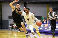 Vermont guard Robin Duncan (4) defends against University at Albany guard Ahmad Clark (2) during the second half of an NCAA college basketball game Saturday, Jan. 5, 2019, in Albany, N.Y. Vermont won the game 80-51. (Hans Pennink / Special to the Times Union)