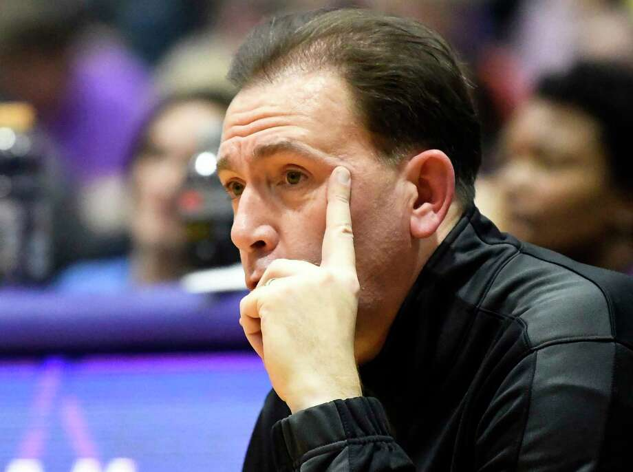 University at Albany head coach Will Brown watches his team play Vermont during the second half of an NCAA college basketball game Saturday, Jan. 5, 2019, in Albany, N.Y. Vermont won the game 80-51. (Hans Pennink / Special to the Times Union) Photo: Hans Pennink / Hans Pennink