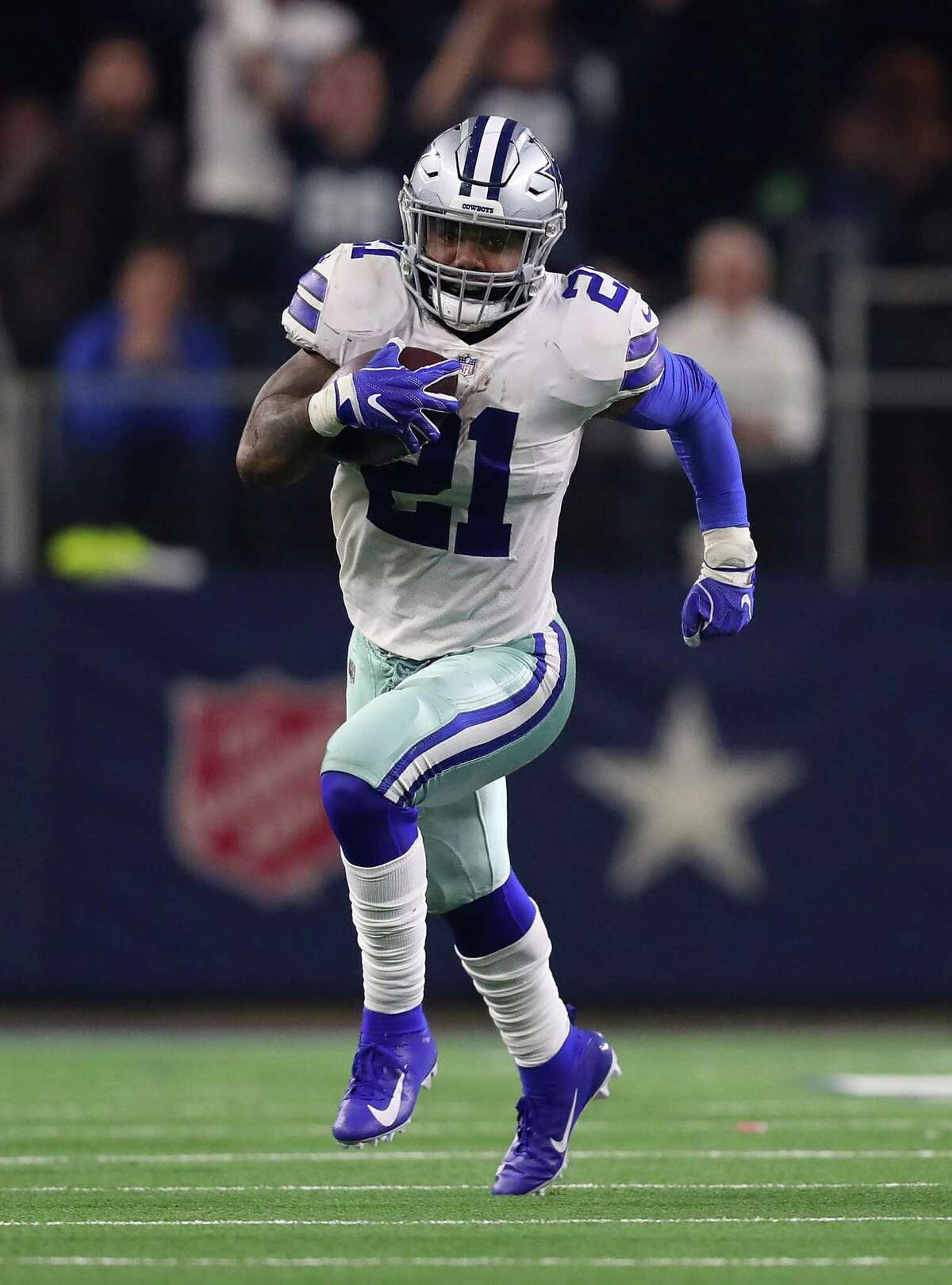 ARLINGTON, TEXAS - JANUARY 05: Ezekiel Elliott #21 of the Dallas Cowboys runs the ball in the second quarter against the Seattle Seahawks during the Wild Card Round at AT&T Stadium on January 05, 2019 in Arlington, Texas. (Photo by Tom Pennington/Getty Images)