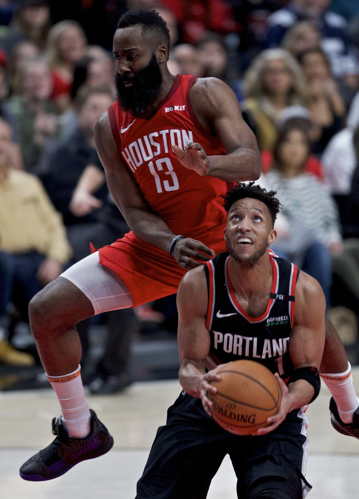 Portland Trail Blazers guard Evan Turner, right, is fouled by Houston Rockets guard James Harden during the second half of an NBA basketball game in Portland, Ore., Saturday, Jan. 5, 2019. (AP Photo/Craig Mitchelldyer)