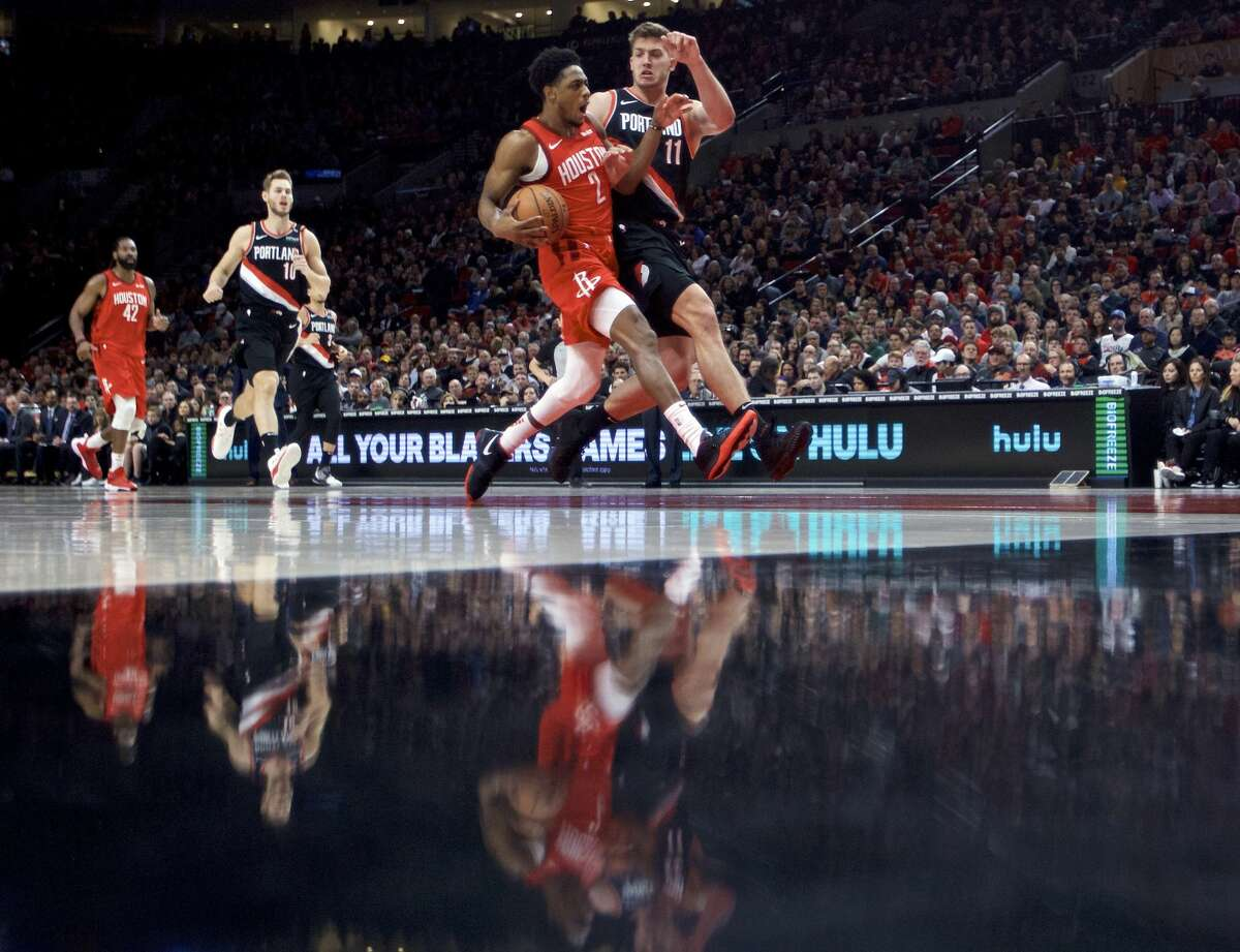 Houston Rockets guard Brandon Knight (2) drives to the basket past Portland Trail Blazers forward Meyers Leonard (11) during the first half of an NBA basketball game in Portland, Ore., Saturday, Jan. 5, 2019. (AP Photo/Craig Mitchelldyer)