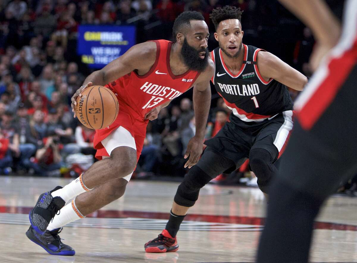 Houston Rockets guard James Harden, left, dribbles past Portland Trail Blazers guard Evan Turner during the first half of an NBA basketball game in Portland, Ore., Saturday, Jan. 5, 2019. (AP Photo/Craig Mitchelldyer)