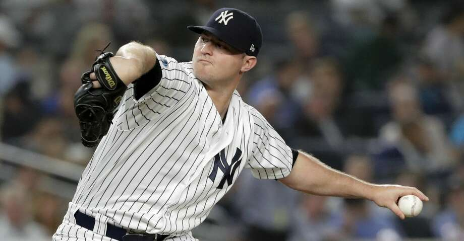 FILE - In this Tuesday, Oct. 9, 2018 file photo, New York Yankees relief pitcher Zach Britton delivers against the Boston Red Sox during the fourth inning of Game 4 of baseball's American League Division Series in New York. A person familiar with the negotiations tells The Associated Press that reliever Zach Britton and the New York Yankees have agreed to a $39 million, three-year contract. The person spoke on condition of anonymity Saturday, Jan. 5, 2019 because the agreement was subject to a successful physical. (AP Photo/Frank Franklin II, File) Photo: Frank Franklin II/Associated Press