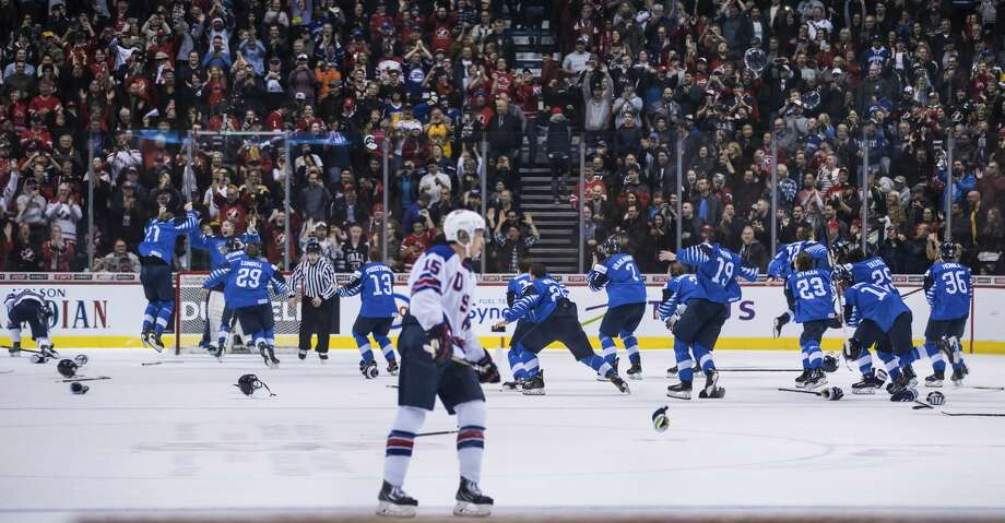 Finland's players celebrate as United States' Jason Robertson (15) skates on the ice after Finland defeated the United States in the gold medal game at the world juniors hockey tournament in Vancouver, British Columbia, Saturday, Jan. 5, 2019. (Darryl Dyck/The Canadian Press via AP) Photo: Darryl Dyck/Associated Press