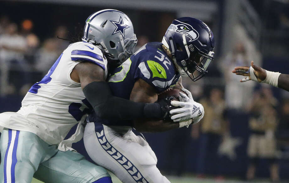 CHRIS CARSON, SEAHAWKS' RUN GAME STRUGGLED 